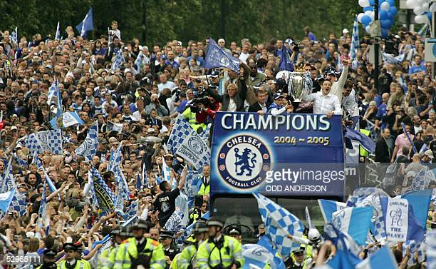 Chelsea players and officials greet the crowd from an open top bus during a parade in west London 22 May 2005 Chelsea won the Premiership for the...