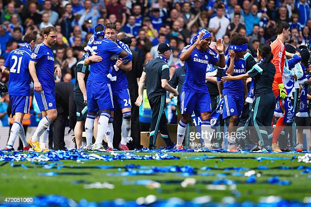 Chelsea players and staff celebrate winning the Premier League title after the Barclays Premier League match between Chelsea and Crystal Palace at...