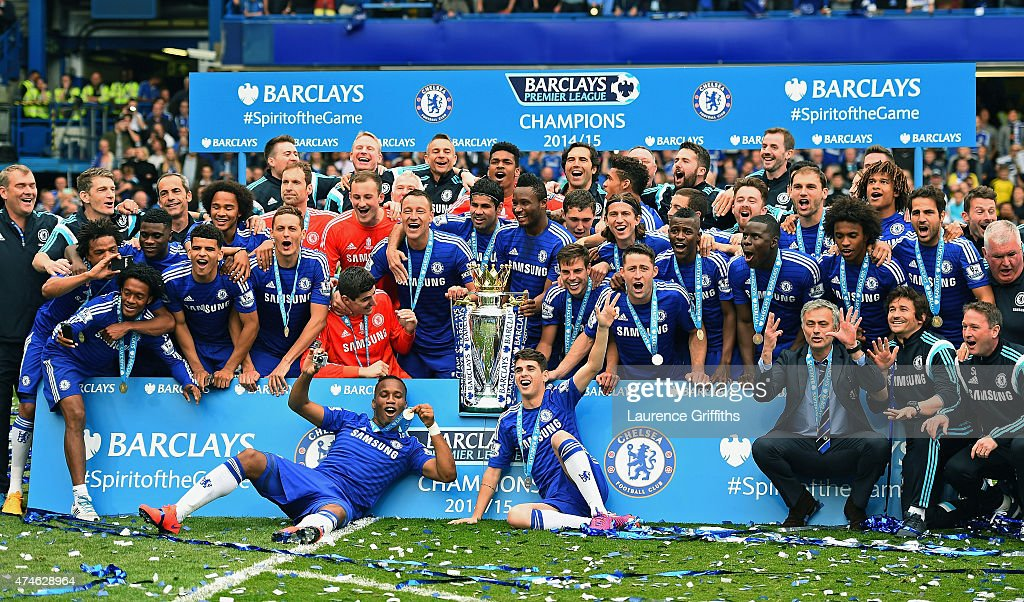 Chelsea players and staffs celebrates the Premier League title after the Barclays Premier League match between Chelsea and Sunderland at Stamford Bridge on May 24, 2015 in London, England.