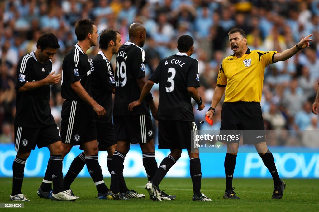 Chelsea players appeal in vain after referee <a gi-track='captionPersonalityLinkClicked' href=/galleries/search?phrase=Mark+Halsey&family=editorial&specificpeople=224397 ng-click='$event.stopPropagation()'>Mark Halsey</a> shows John Terry (#26) of Chelsea a red card during the Barclays Premier League match between Manchester City and Chelsea at The City of Manchester Stadium on September 13, 2008 in Manchester, England.