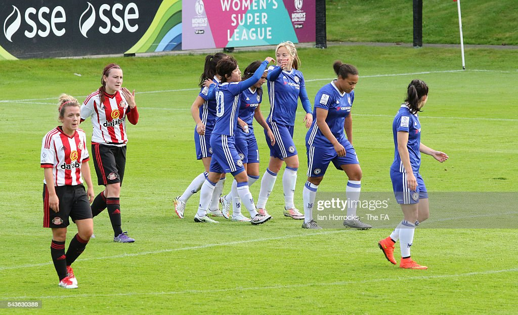 Chelsea players celebrate after scoring the second goal during the WSL 1 League match between Sunderland Ladies and Chelsea Ladies FC at the Hetton Center on June 29, 2016 in Hetton, England.