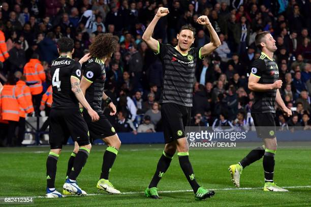 Chelsea players celebrate Chelsea's Belgian striker Michy Batshuayi scoring the opening goal during the English Premier League match between West...
