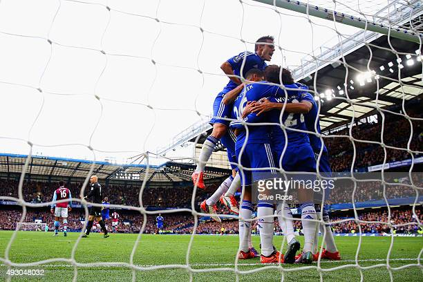Chelsea players celebrate their first goal scored by Diego Costa during the Barclays Premier League match between Chelsea and Aston Villa at Stamford...