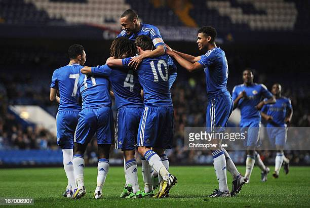 Chelsea players celebrate their fourth goal scored by Nathan Ake during the FA Youth Cup semi final second leg match between Chelsea and Liverpool at...