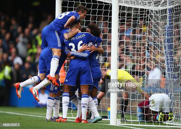 Chelsea players celebrate their team's first goal by Diego Costa during the Barclays Premier League match between Chelsea and Aston Villa at Stamford...