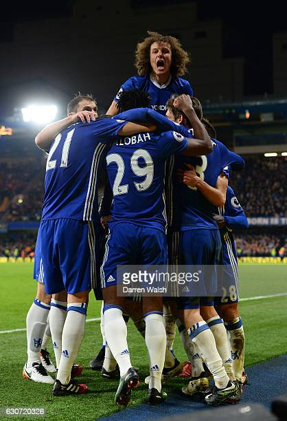 Chelsea players celebrate their team's fourth goal during the Premier League match between Chelsea and Stoke City at Stamford Bridge on December 31...