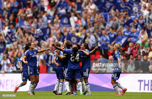 Chelsea players celebrate victory in the Women's FA Cup Final between Chelsea Ladies FC and Notts County Ladies at Wembley Stadium on August 1 2015...