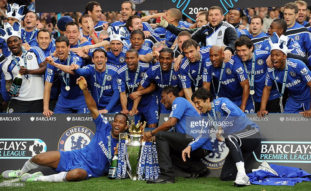 Chelsea players celebrate with the Barclays Premier League trophy after they win the title with a 8-0 victory over Wigan Athletic in the English Premier League football match at Stamford Bridge, West London, England, on May 9, 2010. Chelsea finished the season one pont ahead of 2009 Champions, Manchester United. AFP PHOTO/ADRIAN DENNIS FOR EDITORIAL USE ONLY Additional licence required for any commercial/promotional use or use on TV or internet (except identical online version of newspaper) of Premier League/Football League photos. Tel DataCo +44 207 2981656. Do not alter/modify photo.