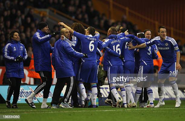 Chelsea players celebrate with the team bench as Ramires scores their first goal during the Barclays Premier League match between Wolverhampton...