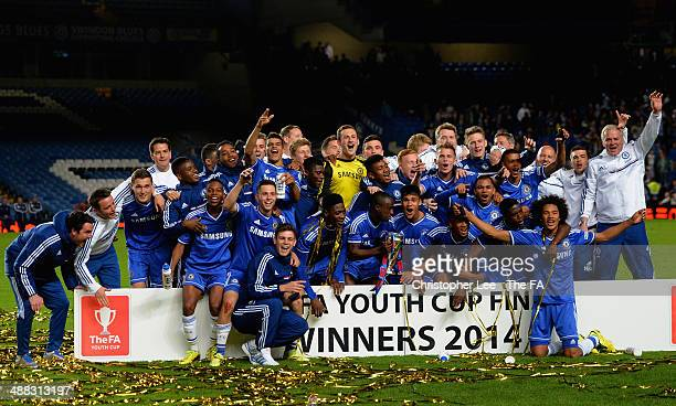 Chelsea players celebrate with the trophy and his team mates during the FA Youth Cup Final Second Leg match between Chelsea U18 and Fulham U18 at...