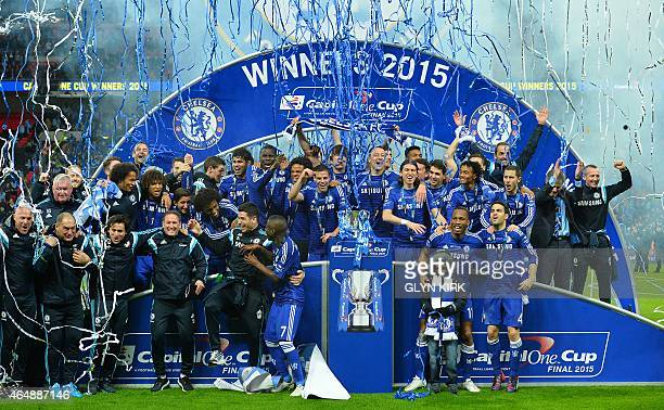 Chelsea players celebrate with the trophy during the presentation after Chelsea won the League Cup final football match against Tottenham Hotspur at...
