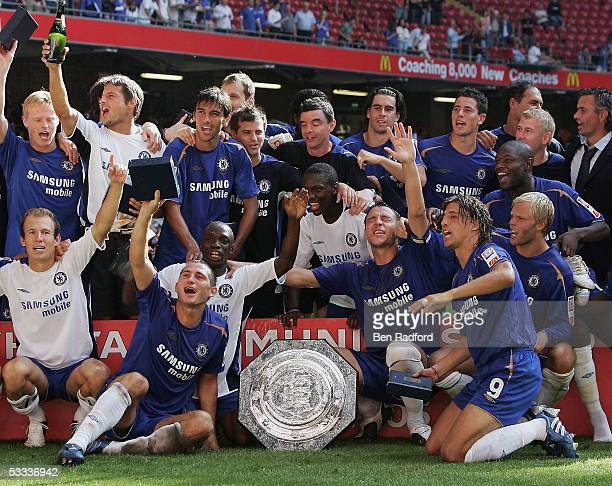 Chelsea players celebrate with the trophy following the FA Community Shield match between Arsenal and Chelsea held at the Millennium Stadium on...