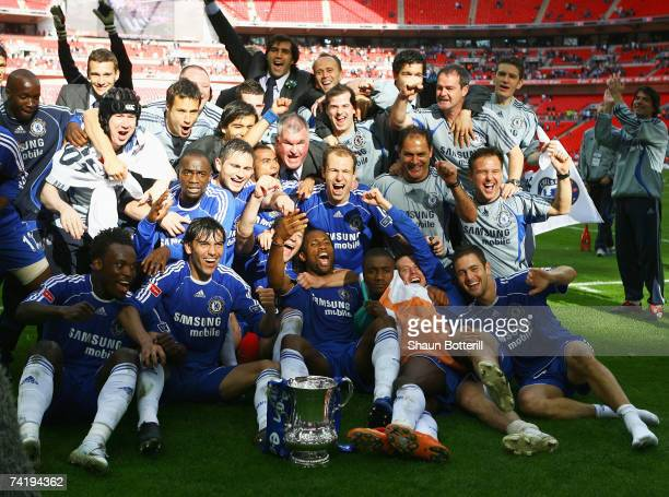 Chelsea players celebrate with the trophy following the FA Cup Final match sponsored by EON between Manchester United and Chelsea at Wembley Stadium...