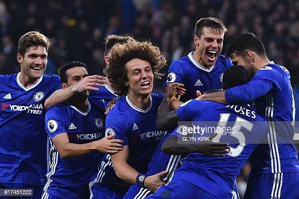 Chelsea players Chelsea's Spanish defender Marcos Alonso Chelsea's Spanish midfielder Pedro Chelsea's English defender Gary Cahill Chelsea's...