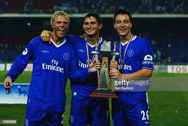 Chelsea players Eidur Gudjohnsen Frank Lampard and John Terry celebrate victory after the FA Premier League Asia Cup Final match between Newcastle...