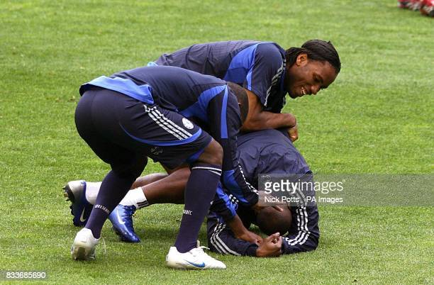 Chelsea players fool around with Claude Makelele