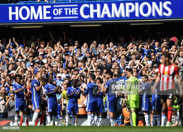 Chelsea players form a guard of honour as he leaves the pitch for the final time during the Premier League match between Chelsea and Sunderland at...