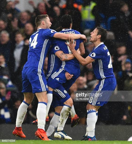 Chelsea players including Chelsea's English defender Gary Cahill and Chelsea's Spanish defender Cesar Azpilicueta celebrate their second goal scored...