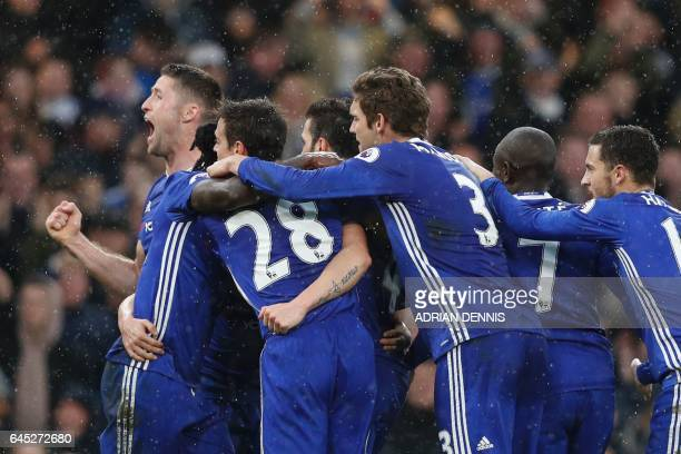 Chelsea players including Chelsea's English defender Gary Cahill celebrate their second goal scored by Chelsea's Spanish midfielder Pedro during the...
