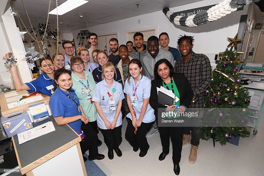 Chelsea players including Thibaut Courtois, Branislav Ivanovic, Eden Hazard, Ruben Loftus-Cheek, Kurt Zouma, Nemanja Matic and Michy Batshuayi pose with staff as they deliver Christmas presents to The Chelsea and Westminster hospital on December 21, 2016 in London, England.