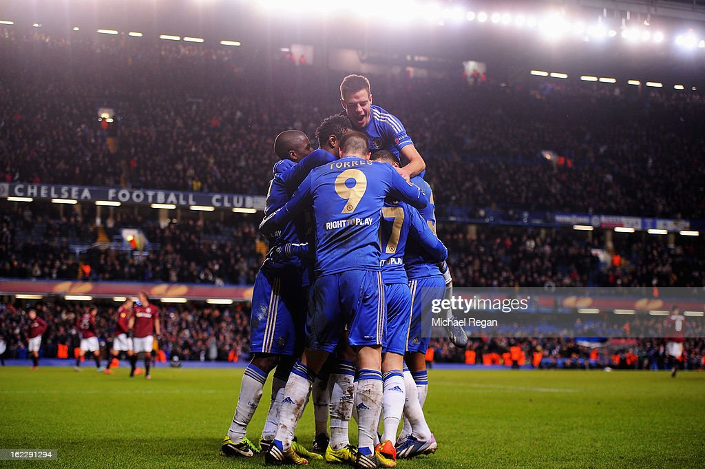 Chelsea players mob goalscorer <a gi-track='captionPersonalityLinkClicked' href=/galleries/search?phrase=Eden+Hazard&family=editorial&specificpeople=5539543 ng-click='$event.stopPropagation()'>Eden Hazard</a> after his goal during the UEFA Europa League Round of 32 second leg match between Chelsea and Sparta Praha at Stamford Bridge on February 21, 2013 in London, England.
