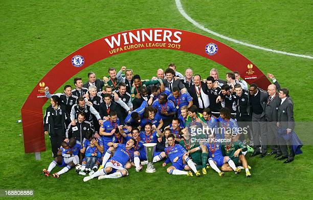 Chelsea players pose with the trophy during the UEFA Europa League Final between SL Benfica and Chelsea FC at Amsterdam Arena on May 15 2013 in...