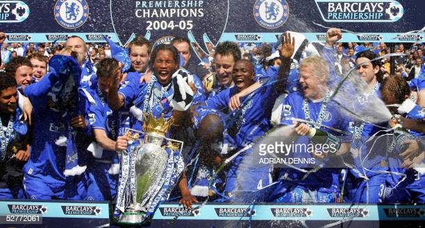 Chelsea players spray champagne over the Barclays Premiership trophy during the celebrations after the game against Charlton at Stamford Bridge in...