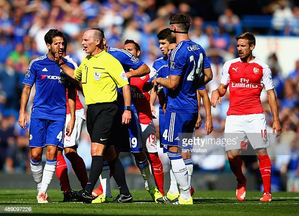 Chelsea players surround referee Mike Dean during the Barclays Premier League match between Chelsea and Arsenal at Stamford Bridge on September 19...