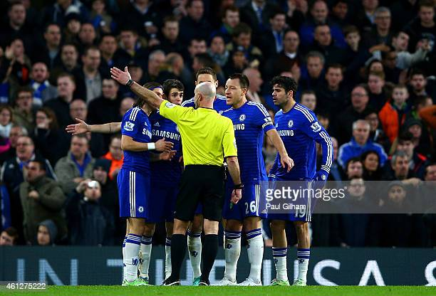 Chelsea players surround referee Roger East during the Barclays Premier League match between Chelsea and Newcastle United at Stamford Bridge on...