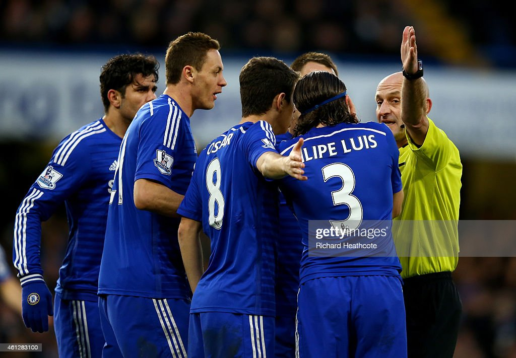 Chelsea players surround referee Roger East during the Barclays Premier League match between Chelsea and Newcastle United at Stamford Bridge on January 10, 2015 in London, England.