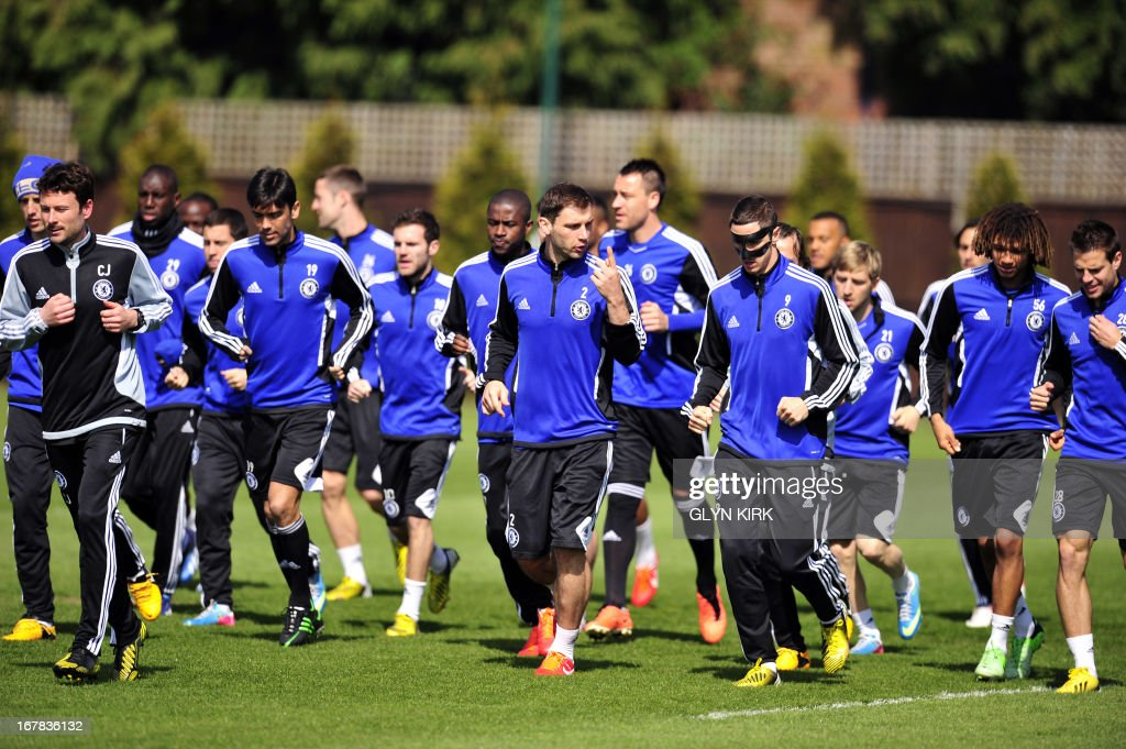Chelsea players warmup during a training session at the club's training ground in Cobham London on May 1 ahead of their UEFA Europa League semifinal...