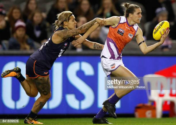 Chelsea Randall of the Allies is tackled by Moana Hope of Victoria during the AFL Women's State of Origin match between Victoria and the Allies at...