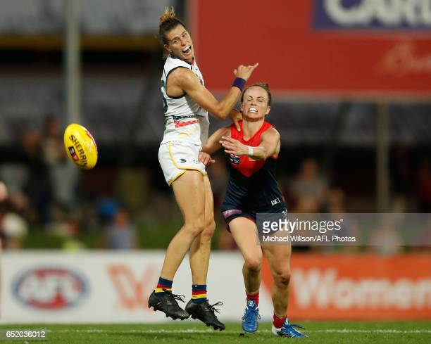 Chelsea Randall of the Crows and Daisy Pearce of the Demons compete for the ball during the 2017 AFLW Round 06 match between the Adelaide Crows and...
