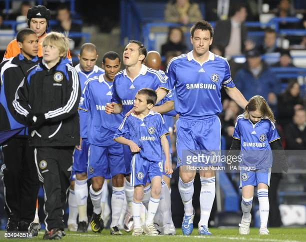 Chelsea 's John Terry leads his team out onto the pitch