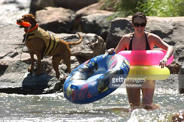 Chelsea Schaul <cq> of Phoenix Arizona has some fun riding the rapids in Confluence Park She was joined by 3 of her college friends Behind her is a...