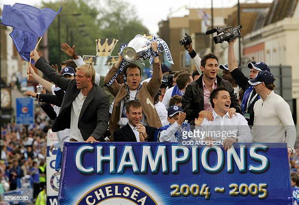 Chelsea striker Arjen Robben holds the Barclay's Premiership trophy aloft as he rides on an opentop bus with Chelsea owner Roman Abramovich Eidur...