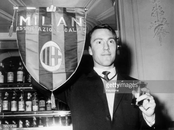 Chelsea striker Jimmy Greaves holds up an AC Milan pennant during a visit to the club in Milan before his transfer to the Italian side 2nd May 1961