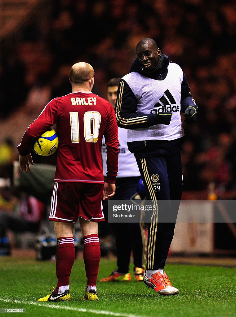 Chelsea sub Demba Ba (r) shares a joke with Boro player Nicky Bailey during the FA Cup Fifth Round match between Middlesbrough and Chelsea at Riverside Stadium on February 27, 2013 in Middlesbrough, England.