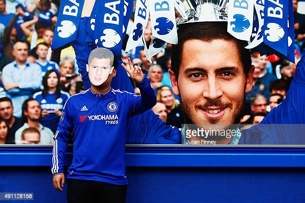 Chelsea supporter wearing a mask of Eden Hazard of Chelsea pose for photographs prior to the Barclays Premier League match between Chelsea and...