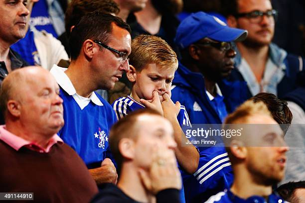 Chelsea supporters are seen after conceding the third goal to Southampton during the Barclays Premier League match between Chelsea and Southampton at...