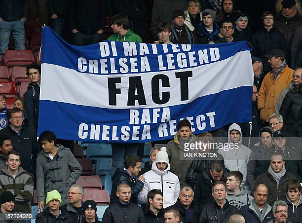 Chelsea supporters wave banners protesting against Chelsea's Spanish interim manager Rafael Benitez during the English Premier League football match...