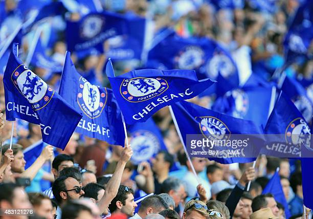 Chelsea supporters wave flags before the FA Community Shield match between Chelsea and Arsenal at Wembley Stadium on August 2 2015 in London England