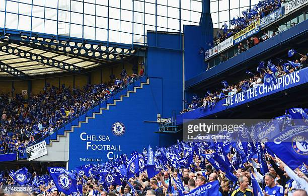 Chelsea supporters wave flags prior to the Barclays Premier League match between Chelsea and Sunderland at Stamford Bridge on May 24 2015 in London...