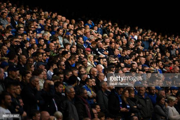 Chelsea supportes follow the action during the Premier League match between Chelsea and Watford at Stamford Bridge on October 21 2017 in London...