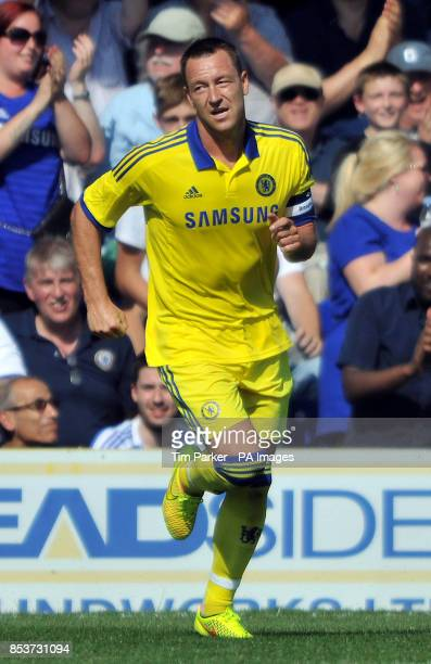 Chelsea XI's John Terry celebrates scoring his second goal during the PreSeason friendly at the The Cherry Red Records Stadium Surrey