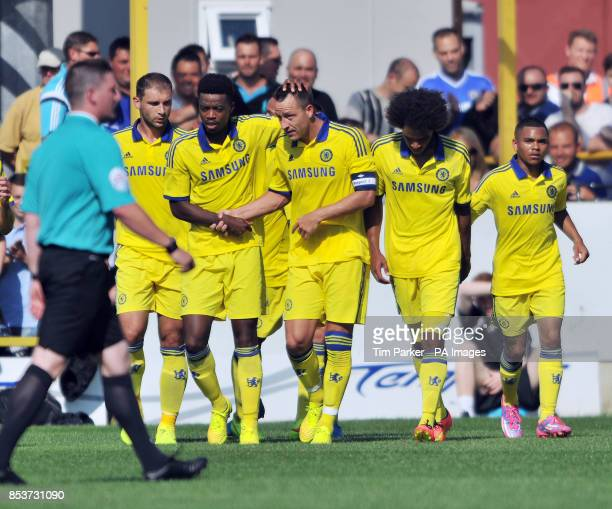 Chelsea XI's John Terry celebrates scoring with teammates during the PreSeason friendly at the The Cherry Red Records Stadium Surrey