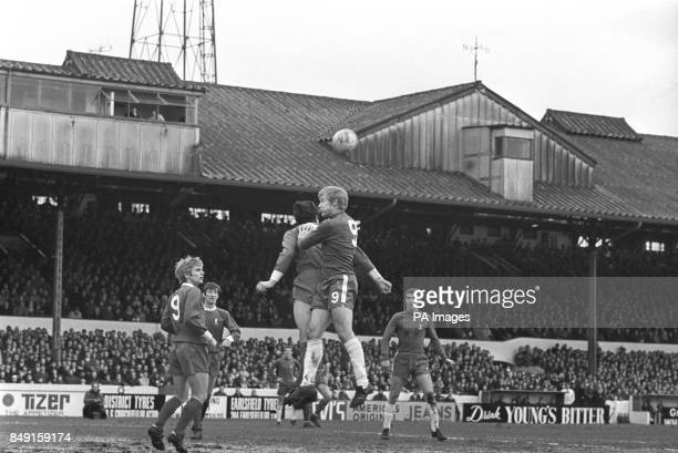 Chelsea's Alan Birchenall and Liverpool captain Ron Yeats go for the ball during a match at Stamford Bridge On the right is Chelsea's Peter Osgood