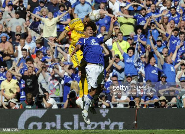 Chelsea's Alex and Everton's Tim Cahill battle for the ball