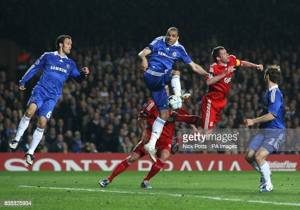 Chelsea's Alex and Liverpool's Jamie Carragher battle for the ball