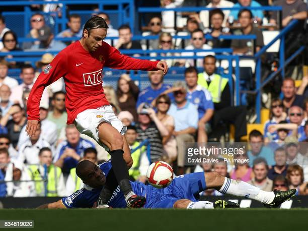 Chelsea's Alex and Manchester United's Dimitar Berbatov battle for the ball